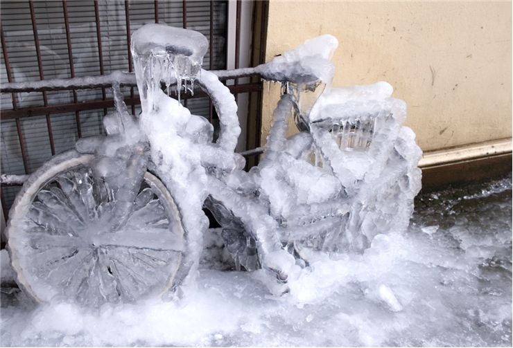 Picture Of Frozen Bicycle And Ice