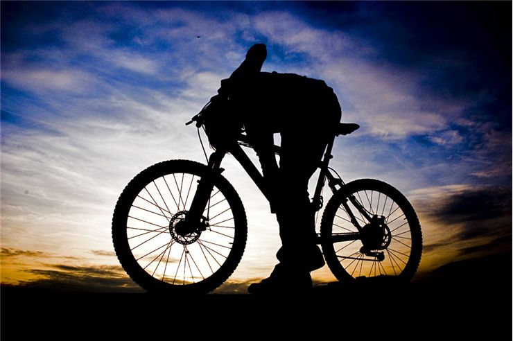 Picture Of Mountain And Bicycle Rider