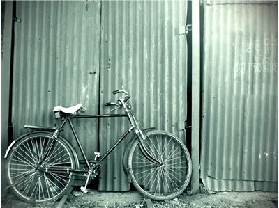 Picture Of Old Bike And Garage Door